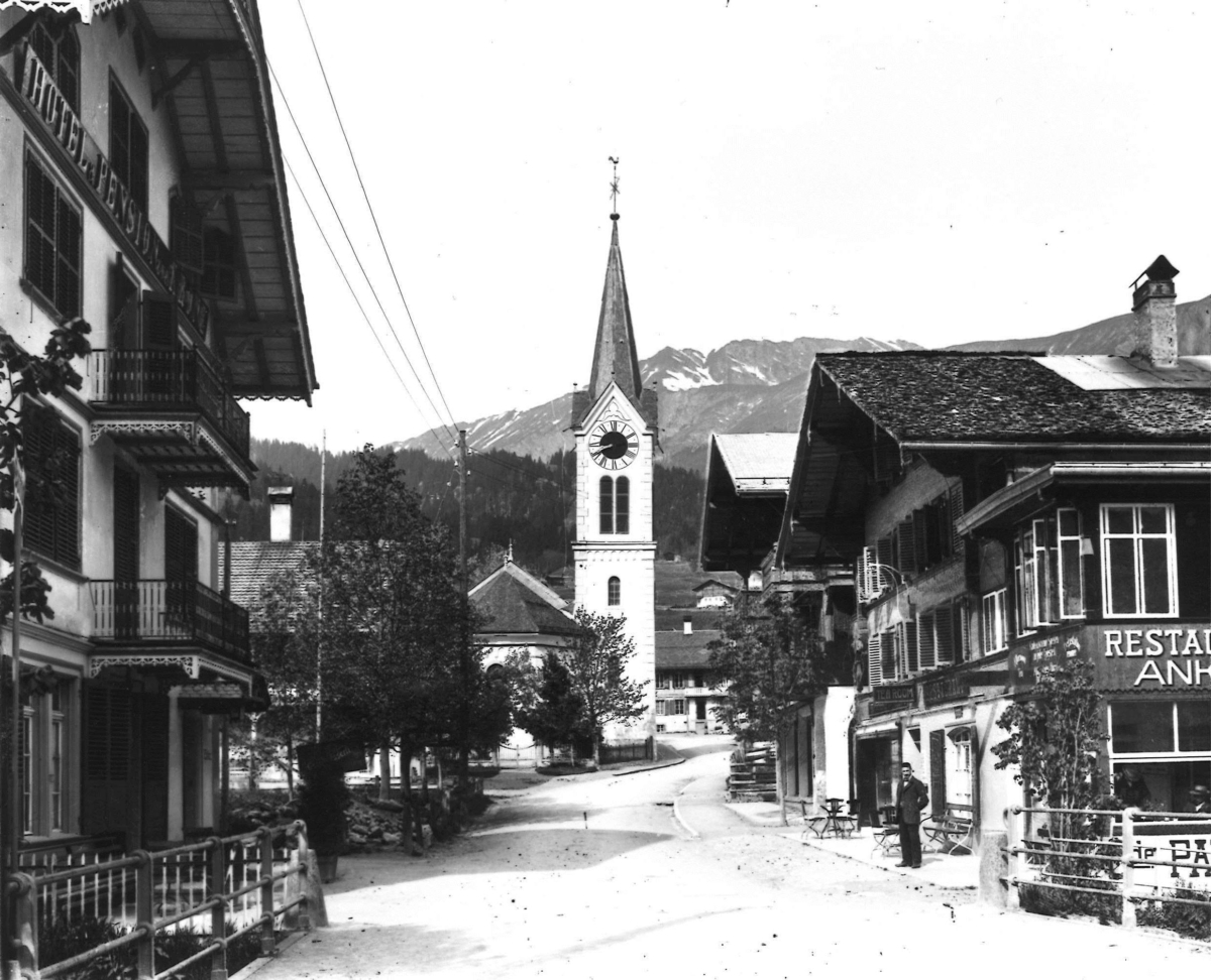 Lenk village with its church after the fire